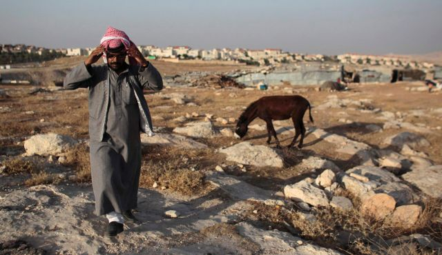 halin tribe walks in his encampment near the Jewish settlement of Maale Adumim, east of Jerusalem, June 16, 2012. Photo by Reuters.