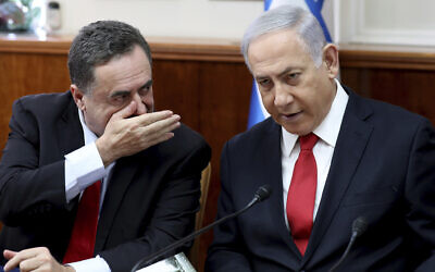 Prime Minister Benjamin Netanyahu, right, listens to Foreign Minister Israel Katz during the weekly cabinet meeting at the Prime Minister's Office in Jerusalem, October 27, 2019. (Gali Tibbon/Pool Photo via AP)