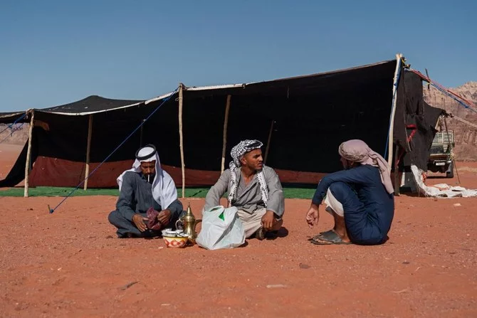 Resting after setting up a Bedouin tent for the Regional Gathering in Jordan. (Photo: Stamos Abatis for CCP)