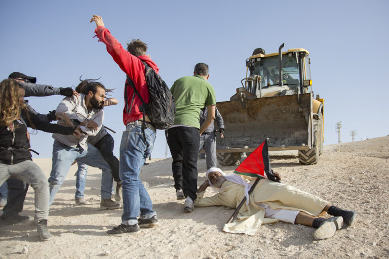 Villagers and activists facing arrest for protesting the attempted demolition of Bedouin Palestinian dwellings at al-Khan al-Ahmar, West Bank, October 15, 2018