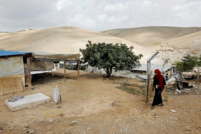 NAHEM KAHANA (AFP) A Palestinian woman walks in the Bedouin village of Khan al-Ahmar, east of Jerusalem, in the West Bank