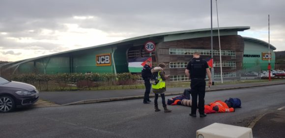 Manchester Action Palestine protesters lock arms outside of JCB World Logistic, Lowlands Rd, Stoke-on-Trent, Thursday, March 7, 2019. (Photo: Manchester Action Palestine)