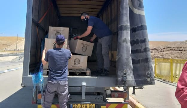 Food distribution in the isolated villages, on Thursday, April 30, 2020.Credit: Yael Moav