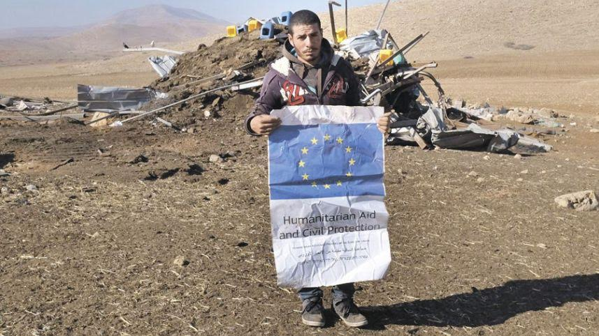 Razi Basharat, the son of mukhtar Abdel Rahim Basharat, in Al Hadidya. It's not clear why the EU has been silent about the confiscation of the tents, 10 Dec. 2015. Photo by Alex Levac.