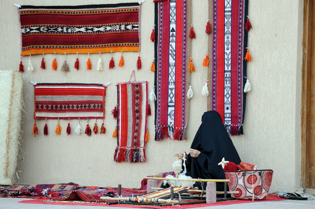 A bedouin woman spinning the wool