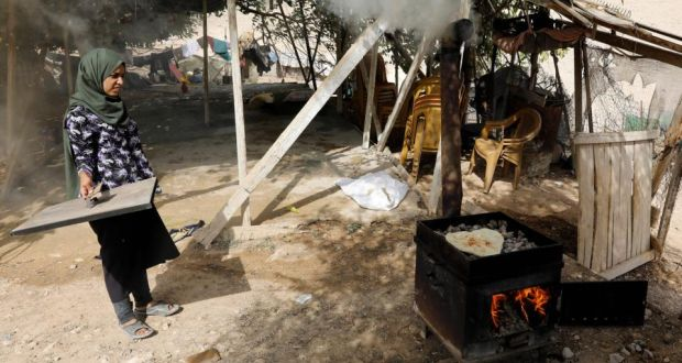 A woman bakes bread in the Palestinian Bedouin village of Khan al-Ahmar, east of Jerusalem, in the occupied West Bank, on October 21st, 2018 Photograph: Menahem Kahana/AFP/Getty