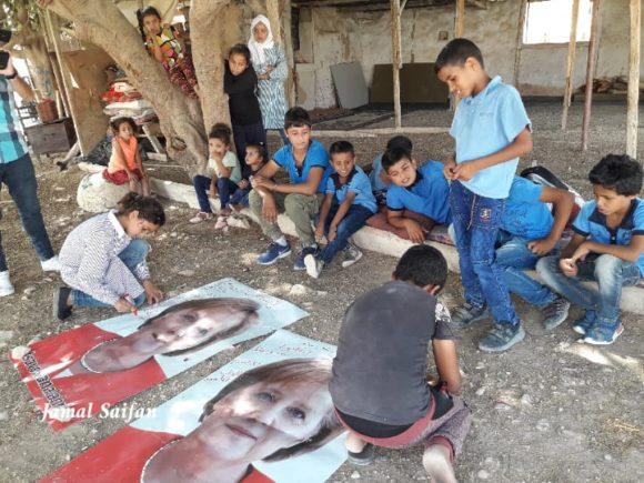 Children in Khan al-Ahmar writing on posters of German Chancellor Angela Merkel on Tuesday, Oct. 2 (Photo Courtesy of Jamal Saifan