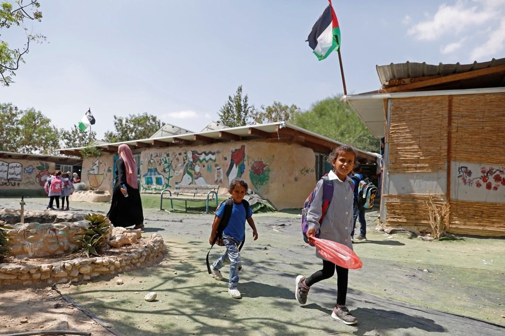 Palestinian Bedouin students walk in the courtyard of their primary school in the village of Khan al-Ahmar in the Israeli-occupied West Bank on September 6, 2018. Photo AFP