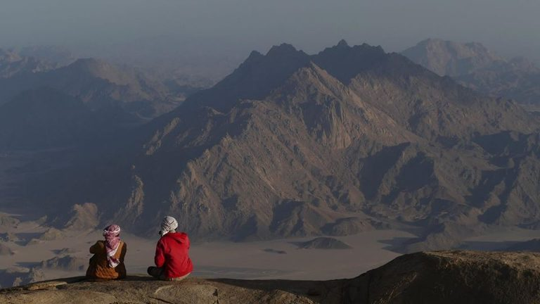 Bedouin tribesmen gaze out to Jebel Um Anab, from Jebel Shayib el Banat. Credit: Ben Hoffler/ Red Sea Mountain Trail